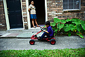 Christopher Mejia plays outside while his aunt Josie San Martin watches him in Metairie, La. He misses his father, Erlin San Martin, who has been detained by immigration authorities.
