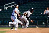 Mesa Solar Sox Franklin Barreto (4), of the Oakland Athletics organization, tags out Gleyber Torres (17) in a rundown during a game against the Scottsdale Scorpions on October 18, 2016 at Sloan Park in Mesa, Arizona.  Mesa defeated Scottsdale 6-3.  (Mike Janes/Four Seam Images)