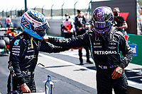1st May 2021; Algarve International Circuit, in Portimao, Portugal; F1 Grand Prix of Portugal, qualification sessions;  Pole sitter BOTTAS Valtteri fin, Mercedes AMG F1 GP W12 E Performance congratulated by team mate HAMILTON Lewis gbr, Mercedes AMG F1 GP W12 E Performance