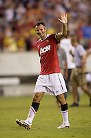 Ryan Giggs (11) of Manchester United waves to the crowd after a friendly match at Lincoln Financial Field in Philadelphia, Pennsylvania.  Manchester United defeated Philadelphia Union, 1-0.