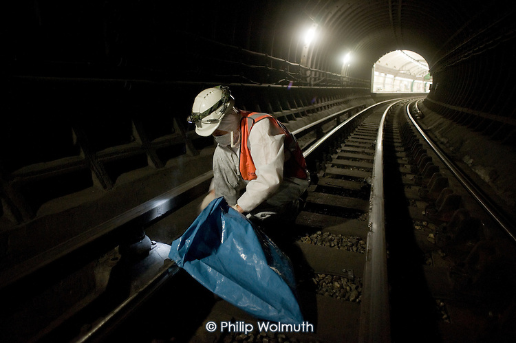 Deep Cleaning Gang employed by a sub-contractor working through the night at Edgware Road tube station on the Bakerloo Line.  The track in the station and 50 metres into each tunnel are cleaned every two weeks to prevent fire and smouldering of accumulated debris, which can result in costly line closures.
