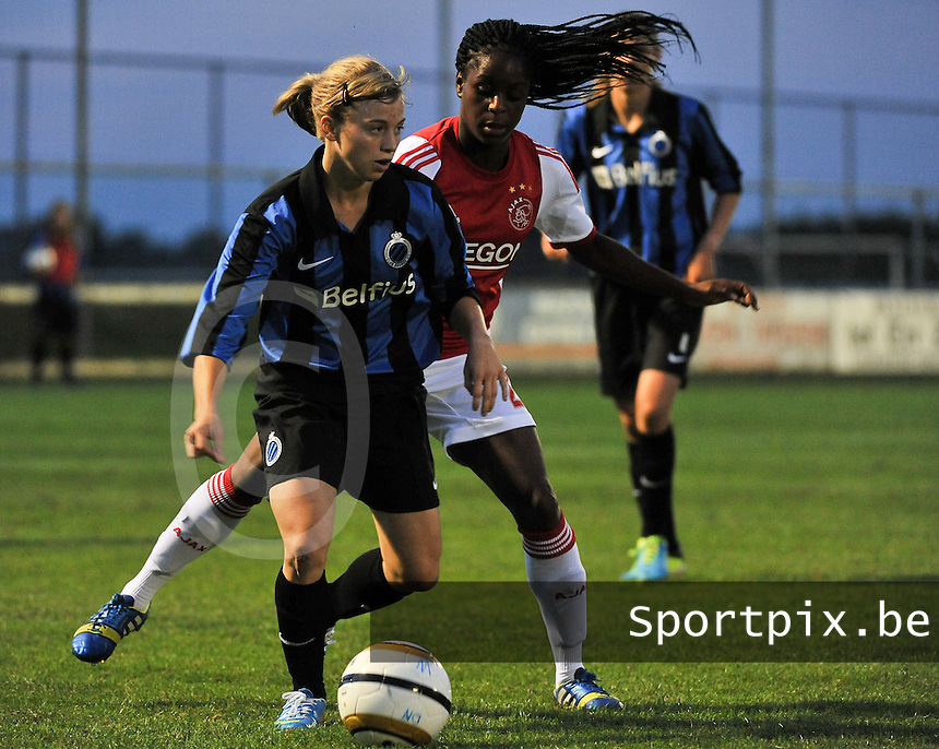 20130830 - VARSENARE , BELGIUM : Brugge's Yana Haesebroek  pictured defending the ball for Ajax' Liza Van Der Most during the female soccer match between Club Brugge Vrouwen and Ajax Amsterdam Dames , of the first matchday in the BENELEAGUE competition. Friday 30 August 2013. PHOTO DAVID CATRY