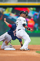 Micah Johnson (3) of the Charlotte Knights shows the umpire the ball after applying a tag to Mookie Betts (12) of the Pawtucket Red Sox at BB&T Ballpark on August 8, 2014 in Charlotte, North Carolina.  The Red Sox defeated the Knights  11-8.  (Brian Westerholt/Four Seam Images)