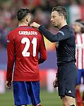 Atletico de Madrid's Yannick Carrasco (l) with the referee Mark Clattenburg during UEFA Champions League match. March 15,2016. (ALTERPHOTOS/Acero)