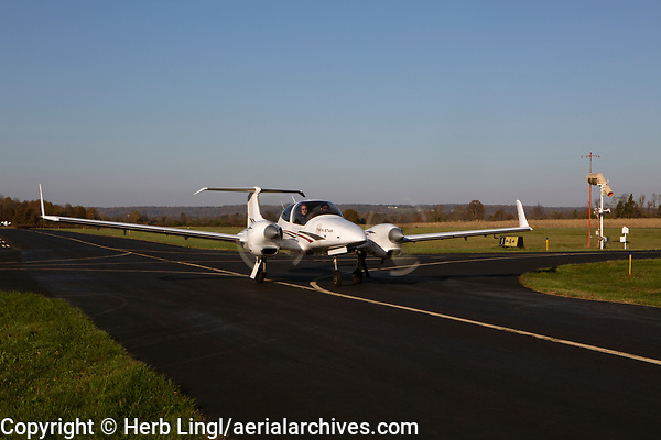 Princeton Flying School chief pilot Jeff Slutsky instructs in Diamond Twin Star, DA42, N704AB as his student taxis for takeoff at the Princeton Airport (39N), Montgomery, Somerset County, New Jersey.  The aircraft has two Thielert, TAE-125-01 engines that burn diesel fuel.