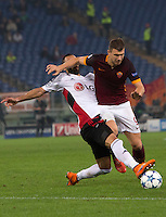 Calcio, Champions League, Gruppo E: Roma vs Bayer Leverkusen. Roma, stadio Olimpico, 4 novembre 2015.<br /> Roma's Edin Dzeko, right, is tackled by Bayer Leverkusen's Omer Toprak during a Champions League, Group E football match between Roma and Bayer Leverkusen, at Rome's Olympic stadium, 4 November 2015.<br /> UPDATE IMAGES PRESS/Riccardo De Luca