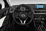 Steering wheel view of a  2014 Mazda Mazda 3 I Grand Touring HatchBack