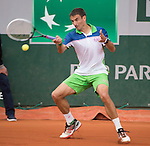 Tommy Robredo (ESP) loses the first set tiebreaker to John Isner (USA)15-13,  at  Roland Garros being played at Stade Roland Garros in Paris, France on May 30, 2014