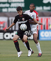 June 15, 2005; Washington, DC, USA; DC United's Santino Quaranta (25) shields the ball away from the Chicago Fire's Tony Sanneh (20) at RFK Stadium. DC United  won the game, 4-3.