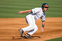 Chris Herrmann #4 of the Miami Hurricanes puts on the brakes after taking his secondary lead off of second base at Durham Bulls Athletic Park May 21, 2009 in Durham, North Carolina.  (Photo by Brian Westerholt / Four Seam Images)