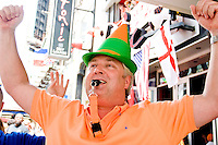 Netherlands fan Richard Jager is triumphant after his team's victory against the Ivory Coast at Tonic, a New York City nightclub, on June 16, 2006.<br /> <br /> The World Cup, held every four years in different locales, is the world's pre-eminent sports tournament in the world's most popular sport, soccer (or football, as most of the world calls it).  Qualification for the World Cup is open to any country with a national team accredited by FIFA, world soccer's governing body. The first World Cup, organized by FIFA in response to the popularity of the first Olympic Games' soccer tournaments, was held in 1930 in Uruguay and was participated in by 13 nations.    <br /> <br /> As of 2010 there are 208 such teams.  The final field of the World Cup is narrowed down to 32 national teams in the three years preceding the tournament, with each region of the world allotted a specific number of spots.  <br /> <br /> The World Cup is the most widely regularly watched event in the world, with soccer teams being a source of national pride.  In most nations, the whole country is at a standstill when their team is playing in the tournament, everyone's eyes glued to their televisions or their ears to the radio, to see if their team will prevail.  While the United States in general is a conspicuous exception to the grip of World Cup fever there is one city that is a rather large exception to that rule.  In New York City, the most diverse city in a nation of immigrants, the melting pot that is America is on full display as fans of all nations gather in all possible venues to watch their teams and celebrate where they have come from.