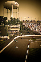 24 May, 2009, Indianapolis, Indiana, USA.Helio Castroneves (#3) leads the field up the back straight on the last lap..©F. Peirce Williams 2009 USA.ref: Raw Image Capture (.NEF) available
