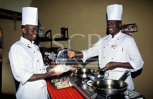 Maasai Mara, Kenya. Smiling chefs at a tourist safari hotel in the reserve.