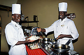 Maasai Mara, Kenya. Smiling chefs at a tourist safari hotel in the reserve.