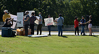 People hold signs Wednesday, Sept. 8, 2021, while standing along Don Tyson Parkway in front of the headquarters for Tyson Foods in Springdale. The event was organized by Venceremos which presented the company with a petition asking for increased safety precautions and paid sick leave for poultry plant workers amid the pandemic. Visit nwaonline.com/210909Daily/ for today's photo gallery.<br /> (NWA Democrat-Gazette/Andy Shupe)