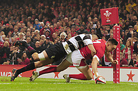 Wales Josh Adams scores his sides first try during the International friendly match between Wales and Barbarians at the Principality Stadium in Cardiff, Wales, UK. Saturday 30 November 2019.