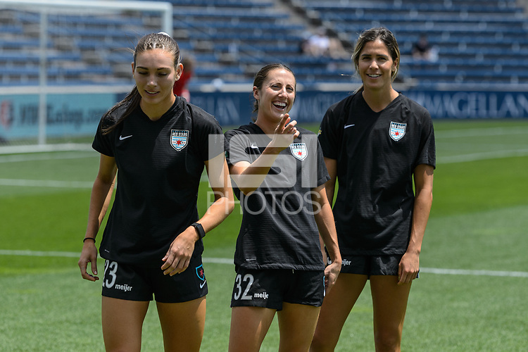 BRIDGEVIEW, IL - JUNE 5: Tatumn Milazzo #23, Zoey Goralski #32, and Katie Johnson #33 of the Chicago Red Stars warm up before a game between North Carolina Courage and Chicago Red Stars at SeatGeek Stadium on June 5, 2021 in Bridgeview, Illinois.
