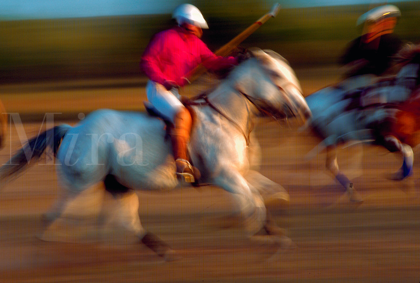 Blur of polo players on horseback