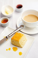 Scones, jam, and cream with afternoon tea at Hullett House, Hong Kong. .