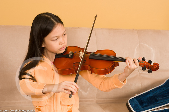 9 year old girl playing musical instrument violin