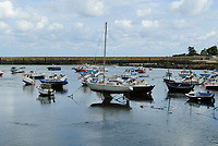 """Barfleur harbour at low tide with small boat and sailing boats stuck in the mud, surrounded by old houses built with stones, English Channel (French: La Manche, """"The sleeve""""), Manche department, France, Europe"""