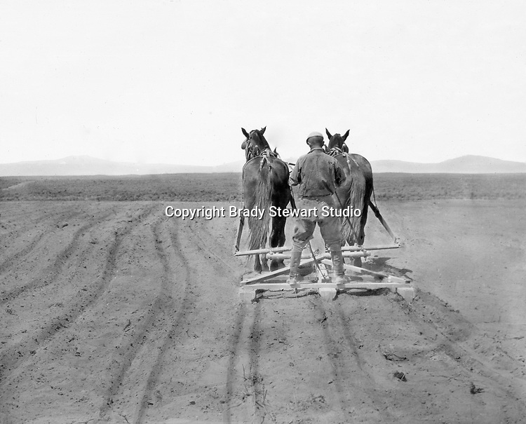 Jerome ID:  Brady Stewart plowing the fields on the 160-acre homestead.  Brady Stewart and three friends went to Idaho on a lark from 1909 thru early 1912. As part of the Mondell Homestead Act, they received a land grant of 160 acres north of the Snake River.  For 2 ½  years, Brady Stewart photographed the adventures of farming along with the spectacular landscapes.