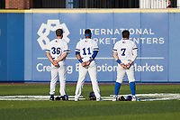(L-R) High Point Rockers outfielders James McOwen (36), Randy Norris (11), and Stephen Cardullo (7) stand for the National Anthem prior to the game against the Southern Maryland Blue Crabs at Truist Point on June 18, 2021, in High Point, North Carolina. (Brian Westerholt/Four Seam Images)