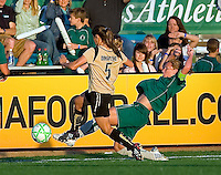St Louis Athletica midfielder Lori Chalupny (17) knocks the ball away from FC Gold Pride midfielder Tina DiMartino (5) during a WPS match at Korte Stadium, in St. Louis, MO, May 9 2009.  St. Louis Athletica won the match 1-0.