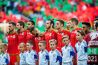 Wales team line up for the National anthem ahead of their UEFA EURO 2016 Group B qualifying round match held at Cardiff City Stadium, Cardiff, Wales, 06 September 2015. EPA/DIMITRIS LEGAKIS