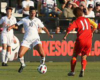 Carli Lloyd #10 of the USA WNT controls the ball in front of Jia You #11 of the PRC WNT during an international friendly match at KSU Soccer Stadium, on October 2 2010 in Kennesaw, Georgia. USA won 2-1.