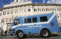 "Un furgone blindato della Polizia durante la protesta delli ""indignados"" davanti alla Camera dei Deputati in occasione del voto di fiducia sul governo, a Roma, 14 ottobre 2011..An Italian Police van is seen outside of the Lower Chamber during a protest held by the ""indignados"" movement, ion occasion of a confidence vote, in Rome, 12 october 2011..UPDATE IMAGES PRESS/Riccardo De Luca"