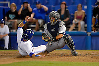 Tampa Yankees catcher Francisco Arcia tags out Andy Burns #9 attempting to score during a game against the Dunedin Blue Jays on April 11, 2013 at Florida Auto Exchange Stadium in Dunedin, Florida.  Dunedin defeated Tampa 3-2 in 11 innings.  (Mike Janes/Four Seam Images)