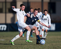 Joey Dillon (4) of Georgetown fights for the ball with Kyle Rutz (17) of Michigan State during the third round of the NCAA tournament at Shaw Field in Washington, DC. Michigan State defeated Georgetown, 1-0.