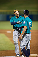 AZL Mariners designated hitter Geoandry Montilla (22) fist bumps his first base coach during the game against the AZL Cubs on August 4, 2017 at Sloan Park in Mesa, Arizona. AZL Cubs defeated the AZL Mariners 5-3. (Zachary Lucy/Four Seam Images)
