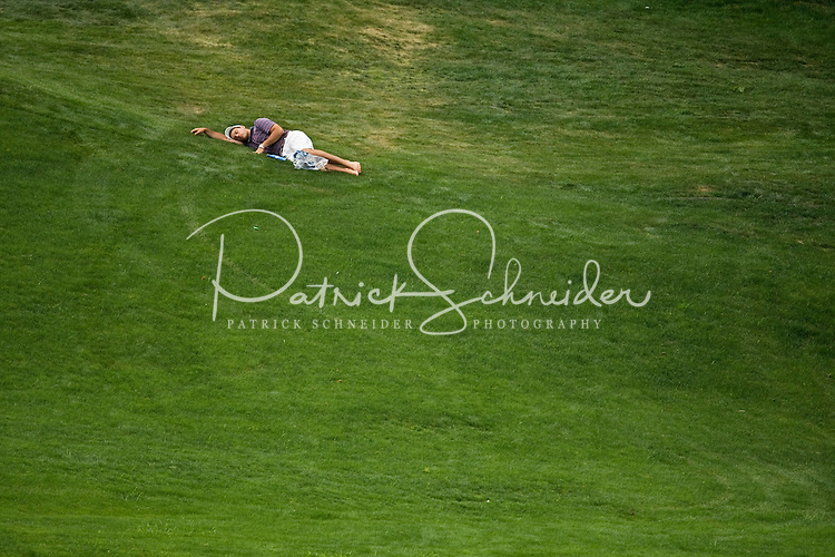 A golf fan relaxes along the edge of the course during the Quail Hollow Championship golf tournament 2009. The event, formerly called the Wachovia Championship, is a top event on the PGA Tour, attracting such popular golf icons as Tiger Woods, Vijay Singh and Bubba Watson. Photo from the third round in the Quail Hollow Championship golf tournament at the Quail Hollow Club in Charlotte, N.C., Saturday, May 02, 2009.