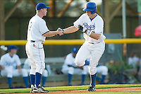 Burlington first baseman Brett Amyx (29) shakes hands with manager Darryl Kennedy (9) as he rounds third base following his 2-run home run in the 4th inning versus Bristol at Burlington Athletic Park in Burlington, NC, Thursday, July 12, 2007.