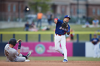 Kannapolis Cannon Ballers shortstop Jose Rodriguez (12) makes a throw to first base after forcing out Curtis Mead (16) of the Charleston RiverDogs at second base at Atrium Health Ballpark on July 1, 2021 in Kannapolis, North Carolina. (Brian Westerholt/Four Seam Images)