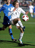 US midfielder Heather O'Reilly (9) plays the ball in front of Italy midfielder Alessia Tuttino (4).  The U.S. Women's National Team defeated Italy 1-0 at Toyota Park in Bridgeview, IL on November 27, 2010 to advance to the Women's World Cup in Germany.