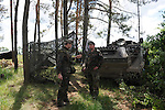 "German soldiers at the platoon command post's fire control center during a break from firing howitzers at the Drawsko Pomorskie Training Area in Poland on June 10, 2015.  NATO is engaged in a multilateral training exercise ""Saber Strike,"" the first time Poland has hosted such war games, involving the militaries of Canada, Denmark, Germany, Poland, and the United States."