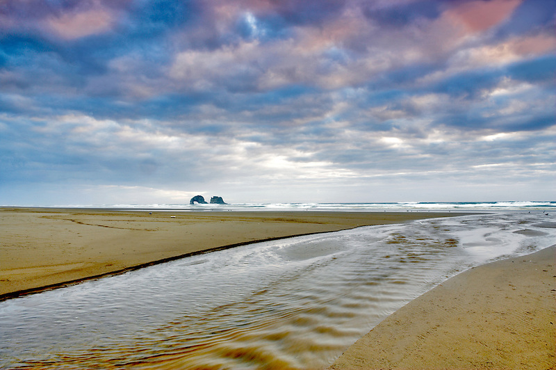 Small stream and twin arches. Rockaway Beach. Oregon