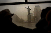 Bus passengers ride past a statue of Lenin in Nizhny Novgorod, Russia's third largest city. Dubbed Russia's third capital, the city of 1.3 million was closed to foreigners for many decades because of its connection with the military...