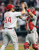 Phillies pitcher Brad Lidge and Catcher Carlos Ruiz celebrate a win on Thursday May 22nd at Minute Maid Park in Houston, Texas. Photo by Andrew Woolley / Four Seam Images.