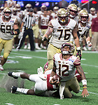 Alabama's Ronnie Harrison sacks Florida State quarterback Deondre Francois injuring his knee late in the second half of the Chick-fil-A Kickoff game at the new Mercedes-Benz Stadium in Atlanta, Georgia on September 2, 2017. Alabama defeated Florida State 24-7.  Photo by Mark Wallheiser/UPI