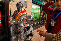 Dancing girls selling snacks on the commercial street, downtown Beijing.  Guy in knight suit sells more snacks on same street...Contact is Evelyn +86 137 1896 4824