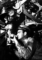 Officer at periscope in control room of submarine.  Ca.  1942.  (Navy)<br /> Exact Date Shot Unknown<br /> NARA FILE #:  080-G-11258<br /> WAR & CONFLICT BOOK #:  944