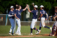 Jace LaViolette (12) high fives teammates after a diving catch during the WWBA World Championship at Lee County Player Development Complex on October 9, 2020 in Fort Myers, Florida.  Jace LaViolette, a resident of Katy, Texas who attends Obra D. Tompkins High School, is committed to Louisiana State.  (Mike Janes/Four Seam Images)