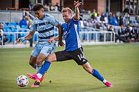 SAN JOSE, CA - MAY 22: Jaylin Lindsey #26 of Sporting Kansas City is challenged by Jackson Yueill #14 of the San Jose Earthquakes during a game between San Jose Earthquakes and Sporting Kansas City at PayPal Park on May 22, 2021 in San Jose, California.