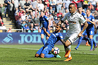 Jordan Ayew of Swansea City runs forward with the ball during the Premier League match between Swansea City and Everton at The Liberty Stadium, Swansea, Wales, UK. Saturday 14 April 2018