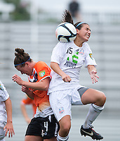 Amanda Naeher (4) of the Charlotte Lady Eagles collides with Gabby Charno (15) of the Long Island Rough Riders during the game at the Maryland SoccerPlex in Boyds, Maryland.  The Charlotte Lady eagles defeated the Long Island Rough Riders, 4-0, to advance to the W-League Eastern Conference Championship.