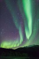 Aurora borealis over the Brooks Range mountains near Wiseman, Alaska.